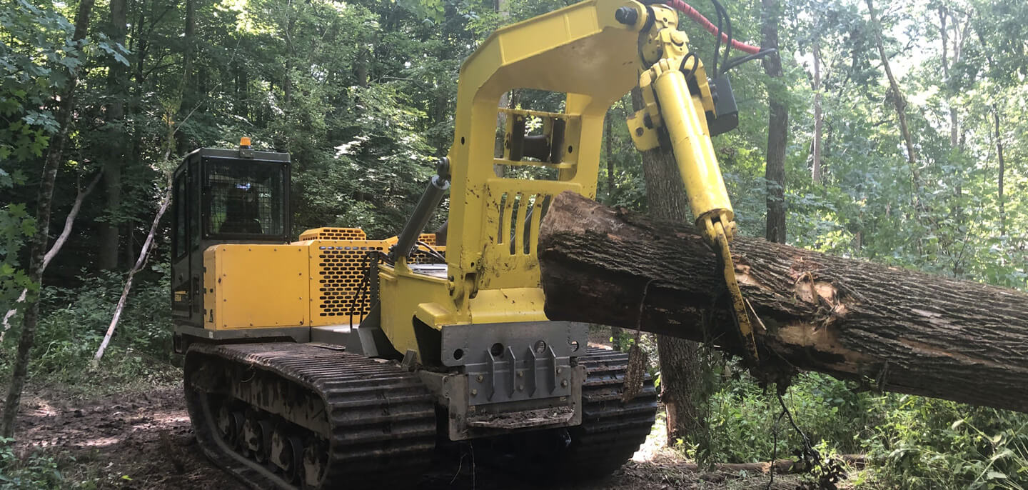 Terramac crawler carrier with grapple hook for forestry applications